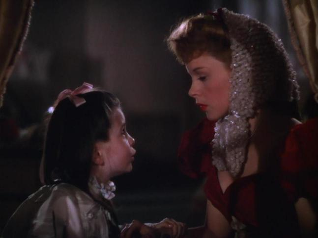 (L-R) Margaret O'Brien, Judy Garland. Image from Meet Me in St. Louis (1944) just before the song begins.