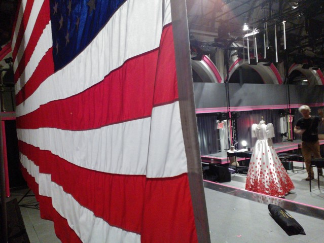 (L-R) Flag backdrop, blood dress, Fitz Patton. Image by Martha Wade Steketee.