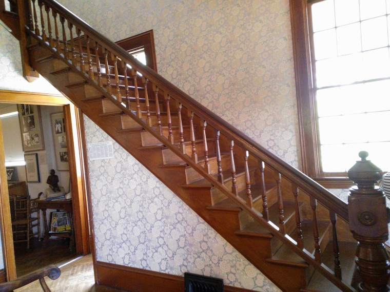 The main stairway that was so absent-mindedly designed it covers up a window and has bannisters and handrail slightly shorter than standard.