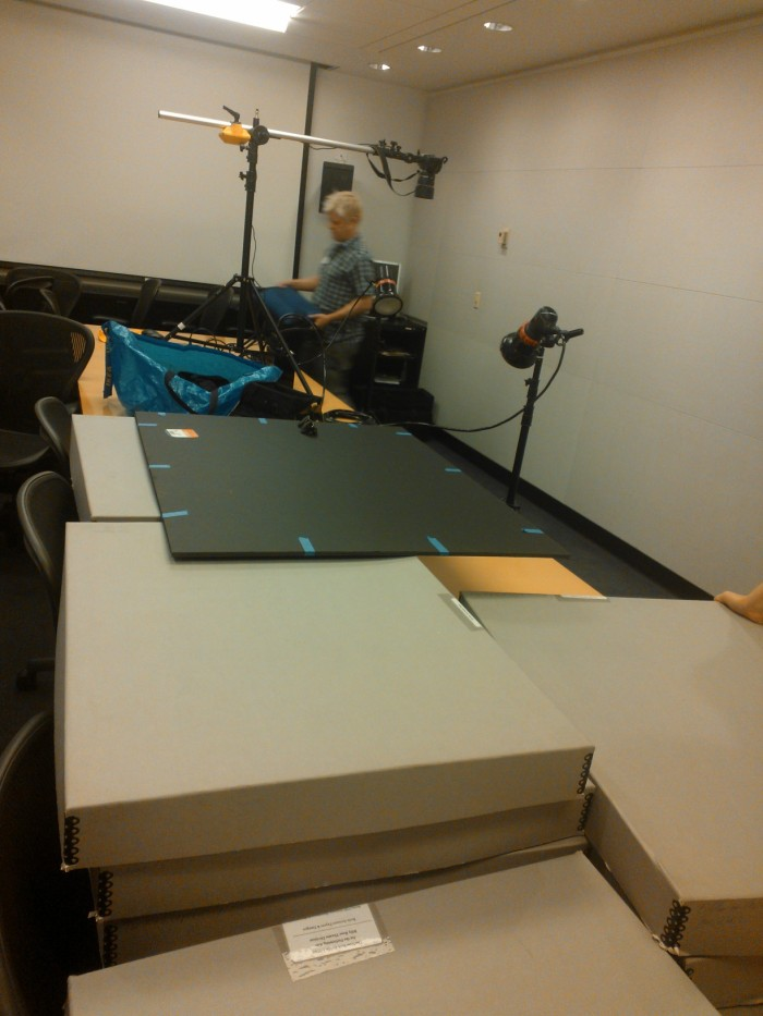 Fitz Patton sets up the shoot -- seen over the wall of boxes we have requested from the scores in the Aronson archives.