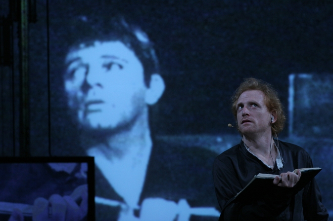 The Wooster Group Hamlet. Richard Burton on Screen, Scott Shepherd at right. Public Theater 2007.